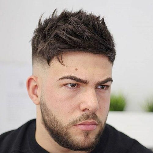 messy textured hair with high fade