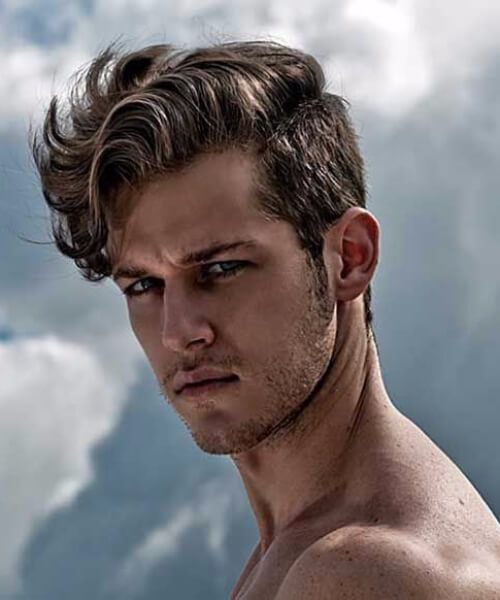 wavy side hairstyle for men with curly hair