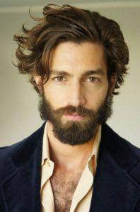 Messy hair with a groomed beard