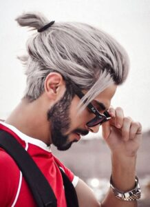man with ponytail and beard